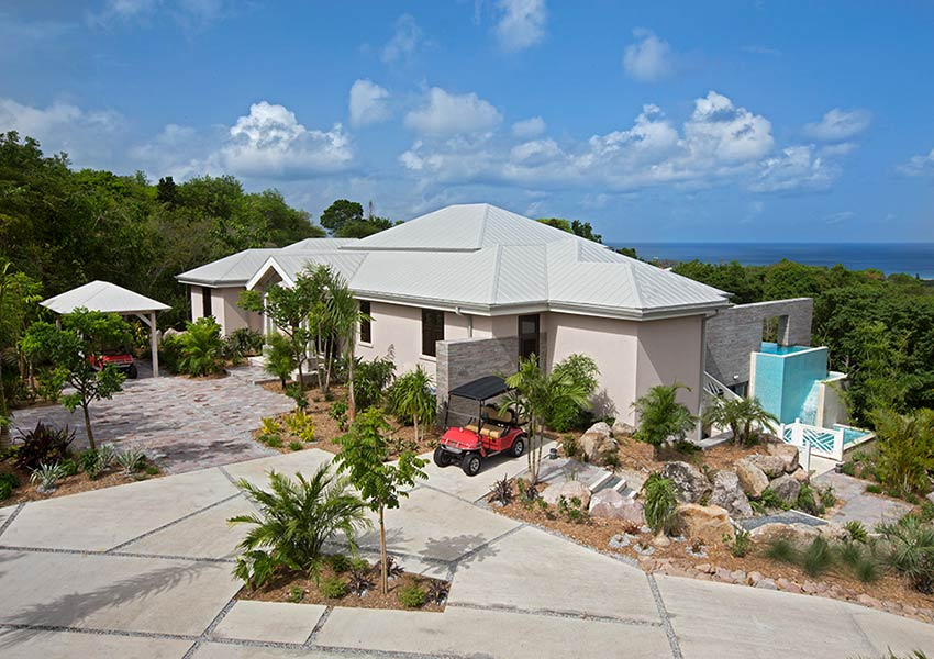 oprit voorbeeld villa poinciana estates bouwgronden four seasons vastgoed nevis wereldwijdleven