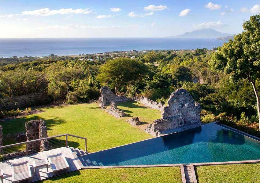 ruine zwembad poinciana estates bouwgronden four seasons vastgoed nevis wereldwijdleven