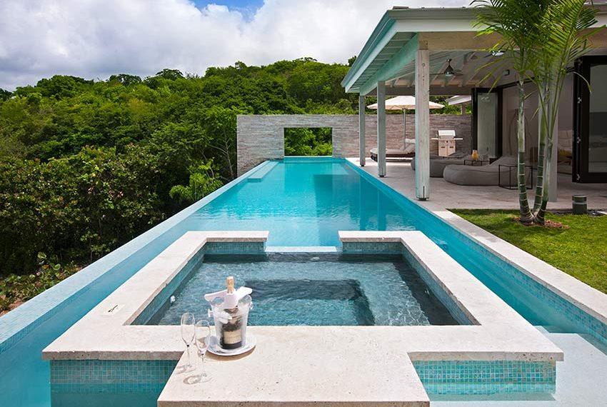 zwembad bubbelbad champagne voorbeeld villa poinciana estates bouwgronden four seasons vastgoed nevis wereldwijdleven
