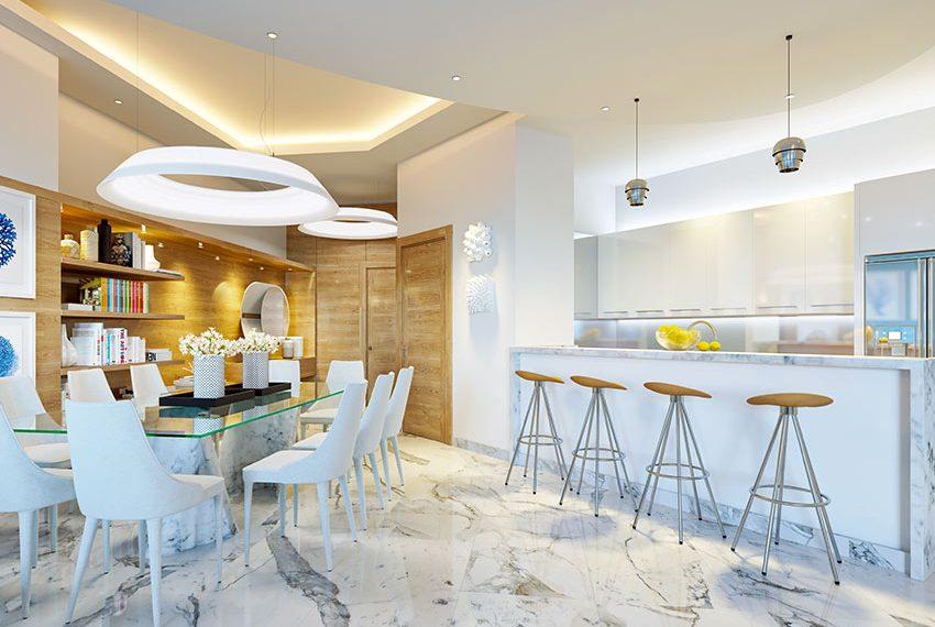 modern design eettafel en keuken met barstoelen in appartement met zeezicht te koop als opbrengsteigendom in juan dolio dominicaanse republiek