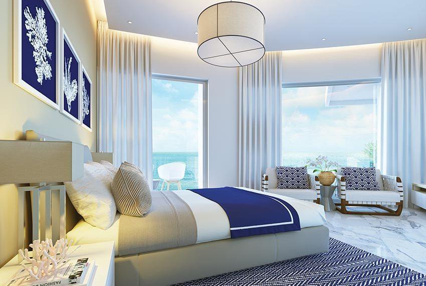 slaapkamer met fris interieur in appartement met zeezicht beleggingseigendom in juan dolio dominicaanse republiek