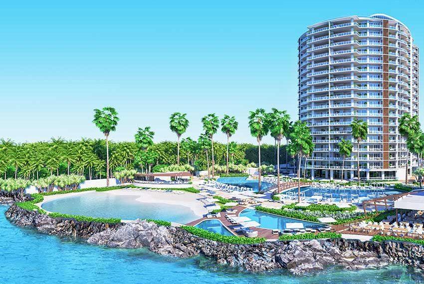 tropische omgeving met veel waterpartijen rond het gebouw juan dolio beleggingsvastgoed