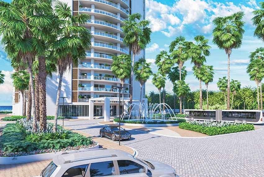 voorkant van condominium hotel palmbomen en fontein juan dolio