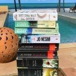 Nederlandstalige boeken lezen aan het privé zwembad met zicht op zee