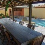 terras tafel zwembad bar vakantievilla Brazilië te koop en te huur