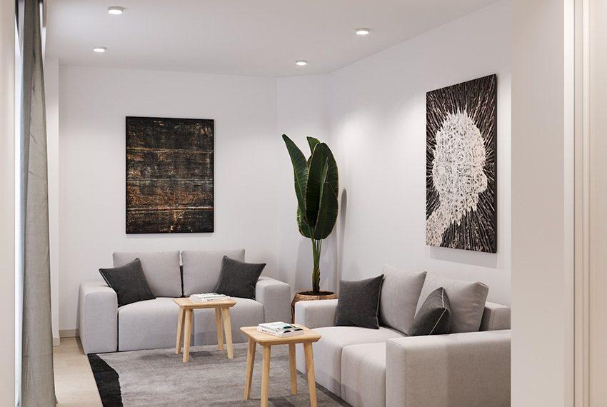 gemeenschappelijke ruimte met comfortabele knusse zithoek grenzend aan open gemeenschappelijke keuken