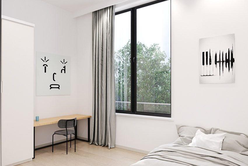 grote glaspartij in studio met bureel en bed compleet gemeubileerd