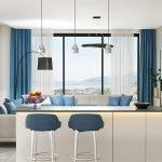 moderne gezellige leefruimte met verhoogde tafel en barkrukken die fantastisch uitzicht bieden