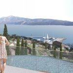 koppel uitkijkend over spa overloopzwembad vakantiewoningen privé jachthaven en hera bay samos