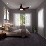 slaapkamer met tweepersoonsbed en veel natuurlijk licht in verhuureenheid van appartementencomplex te koop als belegging