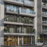 huisvesting voor expats voorgevel gebouw aan schumanplein investeren in brussels vastgoed op toplocatie