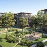 lichtrijke groene binnentuin van vastgoedproject met verschillende gebouwen in opstelling van vierkant watermaal bosvoorde